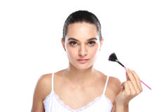 Beautiful caucasian model holding fan brush Royalty Free Stock Photography