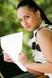 Beautiful caucasian model holding papers Royalty Free Stock Images