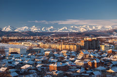 Beautiful Caucasian Mountain view (Greater Caucasus Range). North Caucasus, Russia. View of the city and the mountains in the early winter morning. Greater royalty free stock photography