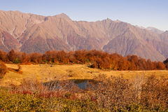 Beautiful Caucasian mountains and lake in autumn season Royalty Free Stock Photography