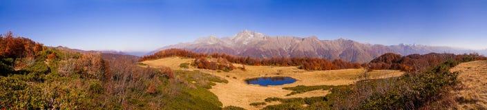 Beautiful Caucasian mountains and lake in autumn season Stock Photo