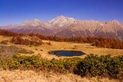 Beautiful Caucasian mountains and lake in autumn season Stock Photography
