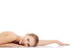 Beautiful caucasian naked woman lying down. Stock Image