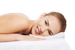 Beautiful caucasian naked woman lying on a massage table and rel Stock Images