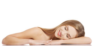 Beautiful caucasian naked woman lying on a table. Royalty Free Stock Photo
