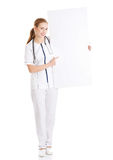 Beautiful caucasian nurse or doctor holding empty white board. Stock Image