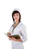 Beautiful caucasian nurse or doctor is writing in a notebook Stock Images