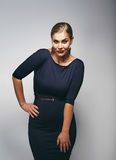 Beautiful caucasian plus size model in dark blue dress Stock Image
