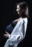 Beautiful caucasian pregnant  woman in nightie Royalty Free Stock Photo