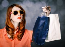Style girl with shopping bags on gray background stock photos