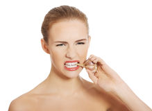 Beautiful caucasian topless woman with raw garlic in mouth. Stock Photos