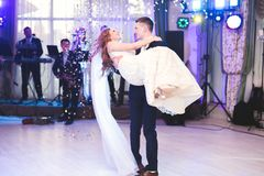 Beautiful caucasian wedding couple just married and dancing their first dance Stock Photo