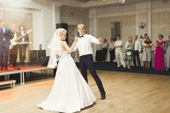 Beautiful caucasian wedding couple just married and dancing their first dance Stock Images