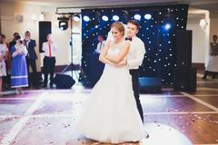 Beautiful caucasian wedding couple just married and dancing their first dance Stock Photos
