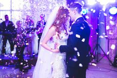Beautiful caucasian wedding couple just married and dancing their first dance.  stock photos