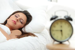 Beautiful Caucasian woman and alarmclock Royalty Free Stock Photos