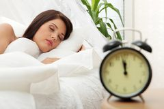 Beautiful Caucasian woman and alarmclock Stock Photography