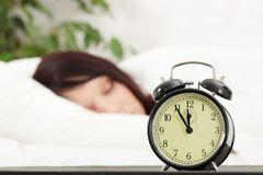 Beautiful Caucasian woman and alarmclock Royalty Free Stock Images