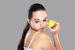 Beautiful caucasian woman with an apple in her hand Stock Photo