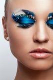 Beautiful caucasian woman with artistic makeup Stock Photos