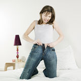 Beautiful caucasian woman in bed Stock Images