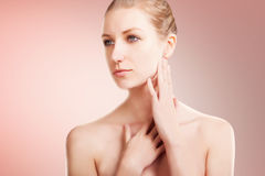 Beautiful caucasian woman with blond hair skin care portrait on pink Royalty Free Stock Images