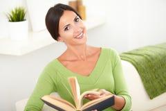 Beautiful caucasian woman browsing a book Stock Image