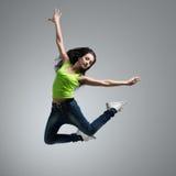Beautiful caucasian woman dancer jumping. In studio stock images