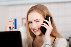Beautiful caucasian woman doing online shopping. Stock Image