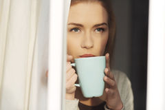 Beautiful caucasian woman drinking hot coffee or tea. Stock Photos