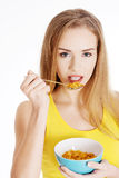 Beautiful caucasian woman eating cereals. Royalty Free Stock Photo
