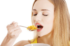 Beautiful caucasian woman eating cereals. Stock Photography