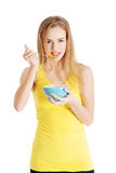 Beautiful caucasian woman eating cereals. Royalty Free Stock Photos