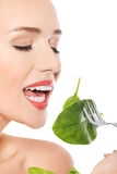 Beautiful caucasian woman eating fresh green luttce from a bowl Royalty Free Stock Images