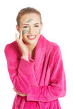 Beautiful caucasian woman with facial mask on face. Royalty Free Stock Image