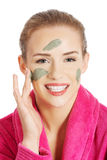 Beautiful caucasian woman with facial mask on face. Stock Image