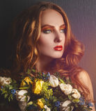 Beautiful caucasian woman with flowers looking away Royalty Free Stock Image