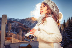 Beautiful caucasian woman going to ice skating outdoor Stock Photo