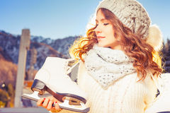 Beautiful caucasian woman going to ice skating outdoor Royalty Free Stock Images