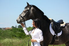 Beautiful caucasian woman and gray horse portrait Royalty Free Stock Photo