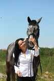 Beautiful caucasian woman and gray horse portrait Stock Photos