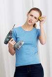Beautiful caucasian woman holding drill. Stock Photos