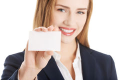 Beautiful caucasian woman holding small personal card. Royalty Free Stock Images