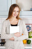 Beautiful caucasian woman holding tablet. Stock Images