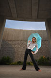 Beautiful Caucasian Woman Holding An Umbrella Stock Photo