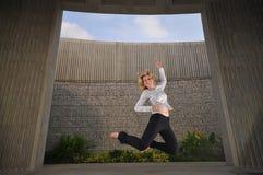 Beautiful Caucasian Woman Jumping Royalty Free Stock Images