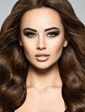 Face of a beautiful  woman with long brown  hair royalty free stock photo
