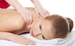 Beautiful caucasian woman lying on the massage table and is bein Stock Photography