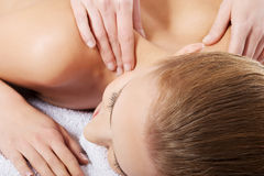 Beautiful caucasian woman lying on the massage table and is bein Royalty Free Stock Photography