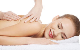 Beautiful caucasian woman lying and relaxing at spa saloon, havi Stock Photo